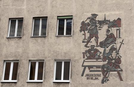 Muurhulp afschilderend jagers op het gebouw in Wenen.