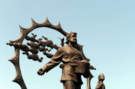 A monument to the settlers in the Altai on the square of October in Barnaul.