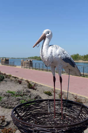Sculpture of a stork on the embankment of the Don River in the village of Romanovskaya, Rostov Region. Editorial