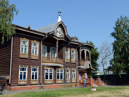 The old wooden building, the former home of the merchants Shadrin on Krasnoarmeysky Avenue in Barnaul. Editorial