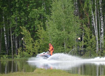 Rescuer EMERCOM on the aquabike on the range of the Noginsk rescue center EMERCOM of Russia.
