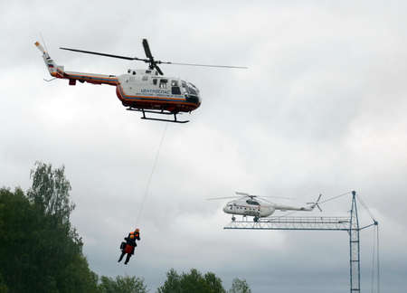 Evacuation with the help of a helicopter BO-105 Centrospas EMERCOM of Russia on the range of the Noginsk rescue center of the Ministry of Emergency Situations. Editorial