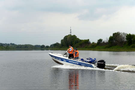 A water police patrol patrols the Oka River.