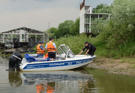 Police officers are preparing the service boat for the raid Editorial