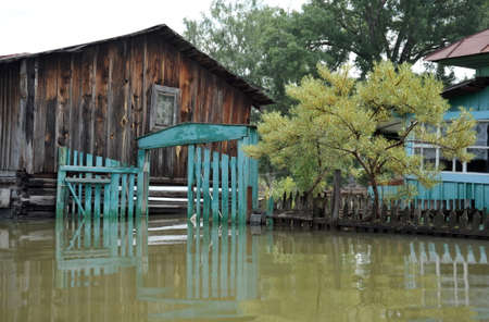 The flooded gate. Flood. The river Ob, which emerged from the shores, flooded the outskirts of the city. Stock Photo