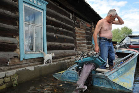 Locals move around the streets by boat. The Ob river, which came out of the banks, flooded the outskirts of the city.