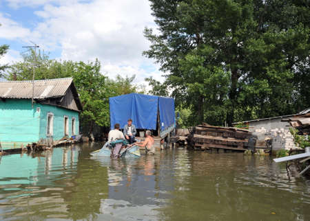 Locals move around the streets by boat. The Ob river, which came out of the banks, flooded the outskirts of the city. Editorial