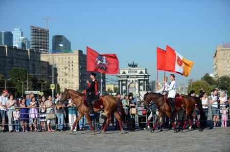 Demonstrative performance by the Kremlin Riding School on Poklonnaya Hill in honor of the Russian Flag holiday. Reklamní fotografie - 88516886