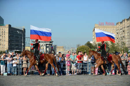 Demonstrative performance by the Kremlin Riding School on Poklonnaya Hill in honor of the Russian Flag holiday. Reklamní fotografie - 88516887