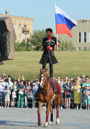 Demonstrative performance by the Kremlin Riding School on Poklonnaya Hill in honor of the Russian Flag holiday. Reklamní fotografie - 88516888