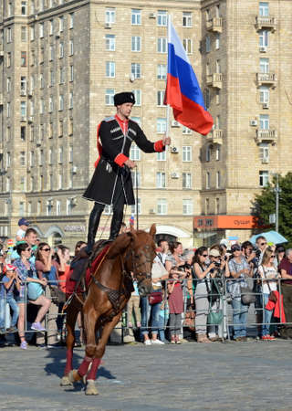 Demonstrative performance by the Kremlin Riding School on Poklonnaya Hill in honor of the Russian Flag holiday. Reklamní fotografie - 88516889