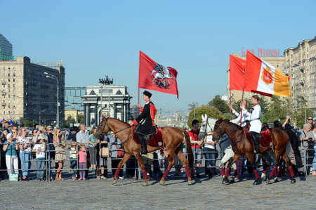 Demonstrative performance by the Kremlin Riding School on Poklonnaya Hill in honor of the Russian Flag holiday. Reklamní fotografie - 88516895