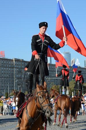 Demonstrative performance by the Kremlin Riding School on Poklonnaya Hill in honor of the Russian Flag holiday. Reklamní fotografie - 88516896