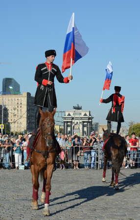 Demonstrative performance by the Kremlin Riding School on Poklonnaya Hill in honor of the Russian Flag holiday. Reklamní fotografie - 88516898
