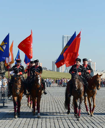 Demonstrative performance by the Kremlin Riding School on Poklonnaya Hill in honor of the Russian Flag holiday. Reklamní fotografie - 88870836