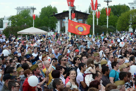 People during the celebration of Victory Day are watching the concert at the Exhibition of Economic Achievements.