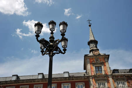 retail scene: A lantern in the Plaza Mayor, one of the central squares of the capital, built during Habsburg. Stock Photo