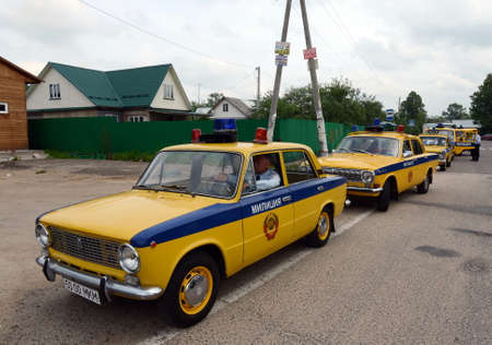 A column of old Soviet cars in the State Automobile Inspection in Borodino.