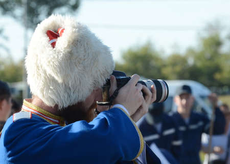 The Cossack photographer shoots at the event.
