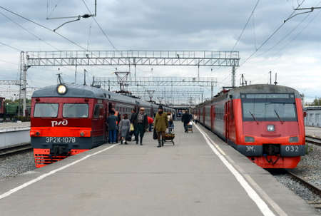 Passengers on the railway platform at the suburban electric trains at Tula station.