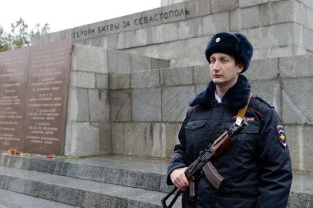 Police officer at the obelisk of Glory on Sapun Mountain in Sevastopol.