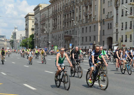 Cyclists ride on the Moscow bicycle around the Garden Ring.