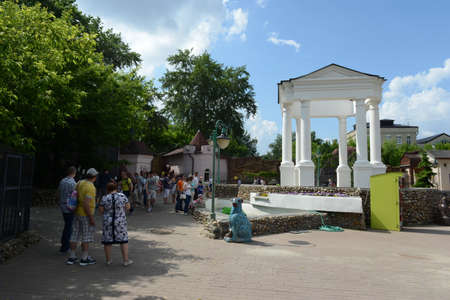 People are walking in the Moscow Zoo.