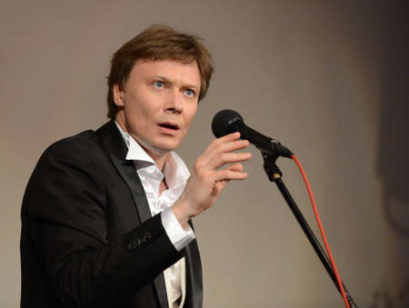 Actor Mikhail Prismotrov performs on stage at the Central House of Artists.