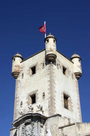 Tower over the Earth gate in Cadiz. Outer walls that separate the old quarter and the modern zone of the city. Editorial