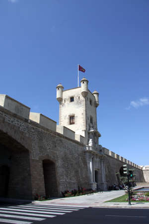 Tower over the Earth gate in Cadiz. Outer walls that separate the old quarter and the modern zone of the city. Stock Photo