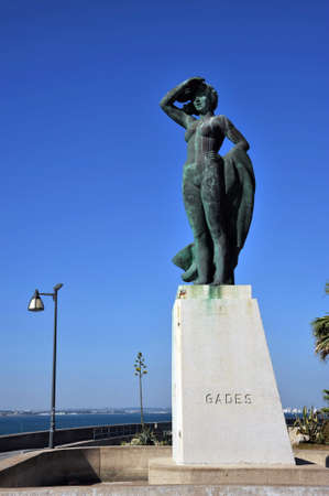 Monument to a woman waiting for a sailor on the shore of the ancient seaport of Cadiz. Stock Photo
