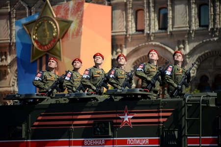 Parade in honor of Victory day in Moscow. Soldiers of the military police on an armored truck