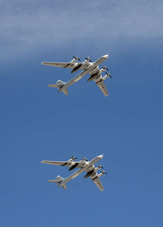 A group of turboprop strategic bombers Tu-95 MS fly over Red Square on the parade dedicated to the Victory Day.