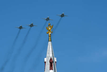Upgraded front-line bomber with variable sweep wing su-24M during the parade, flying in the sky over red square. Stock Photo