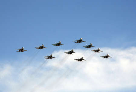 Tactical wing in the group of fighters SU-34, SU-30SM and SU-35 fly during the parade in the sky over Red Square.