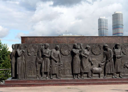 """Sculptural composition-bas-relief at the foot of the monument """"Worker and Collective Farm Girl"""" in Moscow. Editorial"""