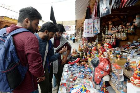 Tourists choose souvenirs on the market in Izmailovo Kremlin.