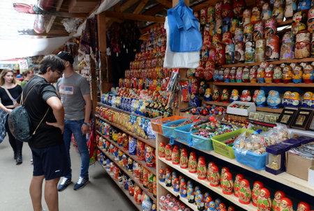 Trade matryoshkas on the market in Izmailovo Kremlin. Editorial