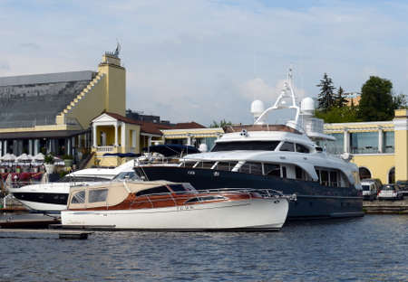 Motor yachts are moored in a parking lot at the Khimki Reservoir in Moscow.