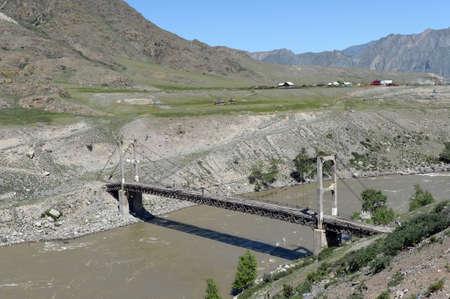 Old suspended bridge of Inina across the Katun River in the Republic of Altai Stock Photo