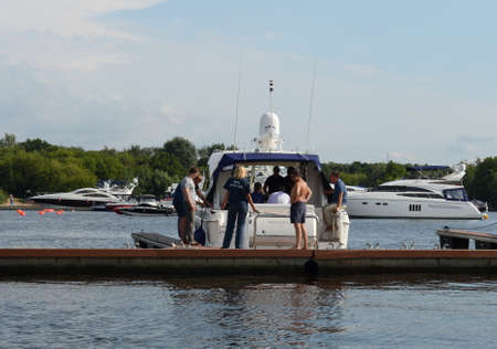 Inspector of the state Inspectorate for small vessels checks the crew of the motor yacht in the waters of the Khimki reservoir in Moscow Editorial