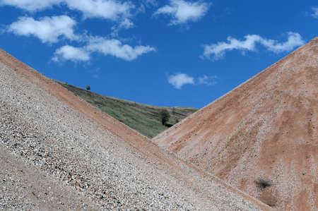 Dumps of spent ore at the Aktash mine. Mountain Altai Stock Photo