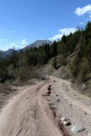 Mountain road in the area of ??the river Yarlyamry. Mountain Altai Stock Photo