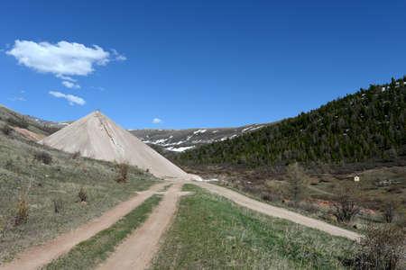 Dumps of spent ore at the Aktash mine. Mountain Altai. Siberia. Russia
