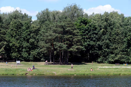 People relax in the natural and historical Park Kuzminki-Lublin