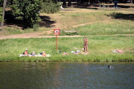 People sunbathe in the park Kuzminki-Lublin Editorial