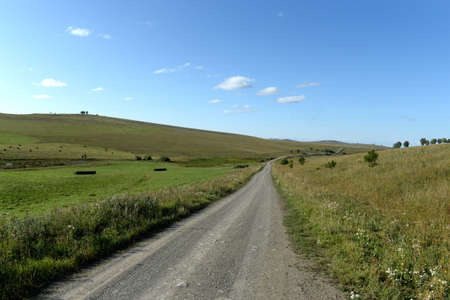 Western Siberia. The road in the foothills of the Altai mountains Stock fotó