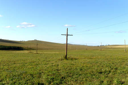 Power line in the foothills of the Altai territory. Western Siberia. Russia Stok Fotoğraf - 130513867