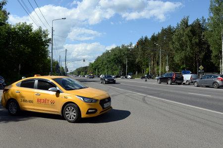 Yellow taxi car on Kashirskoye highway near Moscow