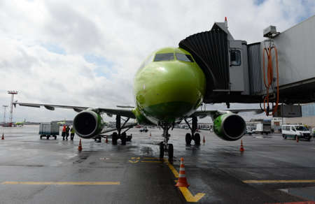 Airbus A319 airplane of S7-Siberia Airlines at a passenger telescopic gangway at Domodedovo International Airport
